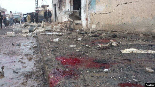 A view shows blood and bread on the ground after what activists said were missiles fired by a Syrian Air Force fighter jet from forces loyal to Syria's President Bashar al-Assad hit a bakery in Halfaya, near Hama December 23, 2012.