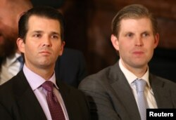 U.S. President Donald Trump's sons Donald Trump Jr. (L) and Eric Trump sit in the audience waiting to watch their father announce his nominee for the empty associate justice seat at the U.S. Supreme Court.