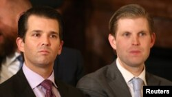 FILE - U.S. President Donald Trump's sons Donald Trump Jr. (L) and Eric Trump sit in the audience waiting to watch their father announce his nominee for the empty associate justice seat at the U.S. Supreme Court, at the White House in Washington, D.C., Jan. 31, 2017.