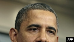 Барак Обама на импровизированной пресс-конференции в Белом доме в четверг 8 декабря 2011г.