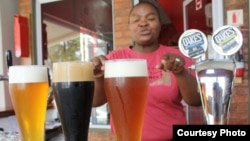 Brewer Happy Sekanka with some of her unique craft beers inside Oakes Brew House in Johannesburg. (VOA / Darren Taylor)