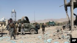 Security forces are deployed at the site of suicide attacks and an ongoing clash between Taliban insurgents and government forces in the main police station in eastern Paktia province, Afghanistan, Jun 18, 2017. The Taliban stormed a police headquarters i