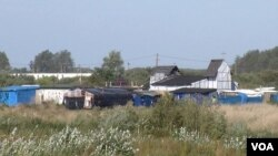 The 'Jungle' migrant camp, seen here, is due to be completely demolished by year's end, in Calais, France. (L. Bryant/VOA)