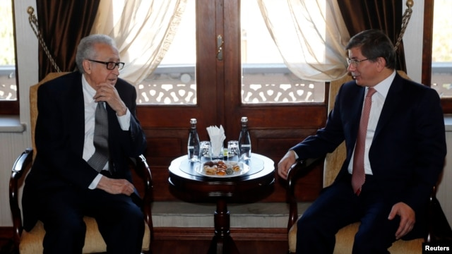 U.N. Special Representative for Syria Lakhdar Brahimi (L) meets with Turkish Foreign Minister Ahmet Davutoglu in Ankara, Oct. 25, 2013.