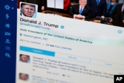 FILE - Photo shows President Donald Trump's tweeter feed on a computer screen in Washington.