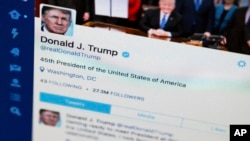 FILE - A photo shows President Donald Trump's Twitter feed on a computer screen.
