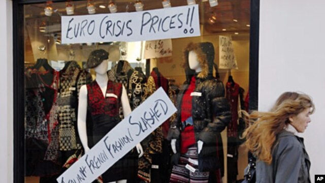 A pedestrian passes a shop in Brighton southern England, December 15, 2011
