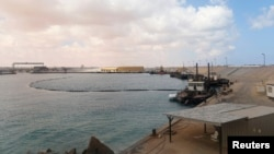 FILE - A view of part of the Es Sider oil export terminal in Ras Lanuf, west of Benghazi, March 11, 2014.