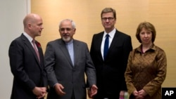 British Foreign Secretary William Hague, left, Iranian Foreign Minister Mohammad Javad Zarif, second left, Germany's Foreign Minister Guido Westerwelle, and EU High Representative for Foreign Affairs, Catherine Ashton, right, in Geneva, Nov. 9, 2013.