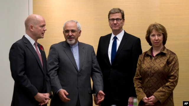 ritish Foreign Secretary William Hague, left, Iranian Foreign Minister Mohammad Javad Zarif, second left, Germany's Foreign Minister Guido Westerwelle, and EU High Representative for Foreign Affairs, Catherine Ashton, right, gather for the third day of closed-door nuclear talks at the Intercontinental Hotel in Geneva Switzerland, Saturday, Nov. 9, 2013.