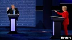 Republican presidential nominee Donald Trump and Democratic presidential nominee Hillary Clinton speak during their first presidential debate at Hofstra University in Hempstead, N.Y., Sept. 26, 2016.