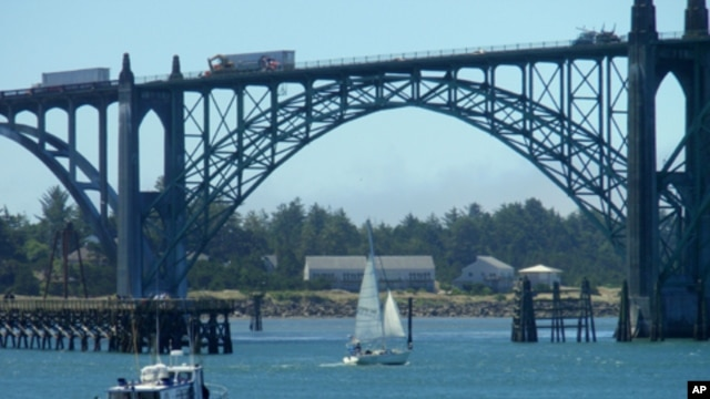 A charter fishing boat heads to sea from Newport, Oregon.