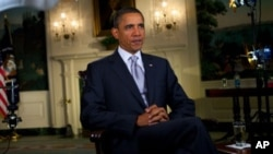 US President Barack Obama records the weekly address, 23 Oct 2010