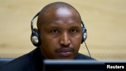 FILE - Congolese warlord Bosco Ntaganda looks on during his first appearance before judges at the International Criminal Court in the Hague, March 26, 2013.