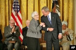 "FILE - ""To Kill a Mockingbird"" author Harper Lee received the Presidential Medal of Freedom from President George W. Bush in 2007."