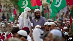 FILE - Supporters of banned sectarian group Sipah-e-Sahaba listen to their leaders at a gathering in Islamabad, Pakistan, Oct. 4, 2013. Pakistan's DAWN newspaper says that 41 of the 64 extremist organizations banned by the government operate freely online