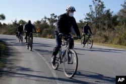 President-elect Joe Biden rides a bike at Cape Henlopen State Park on Saturday, Nov. 14, 2020, in Lewes, Del. (AP Photo/Alex Brandon)
