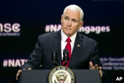 """Vice President Mike Pence addresses the Atlantic Council's """"NATO Engages The Alliance at 70"""" conference, in Washington, April 3, 2019."""