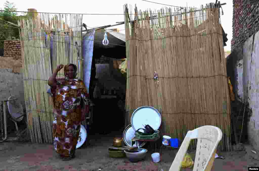 An Eritrean refugee poses for a picture inside her home in Khartoum, Sudan, June 19, 2014.