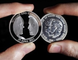 The official coin, left, commemorating the wedding of Prince William to Kate Middleton. It is next to the wedding coin of the Prince of Wales and Lady Diana Spencer.