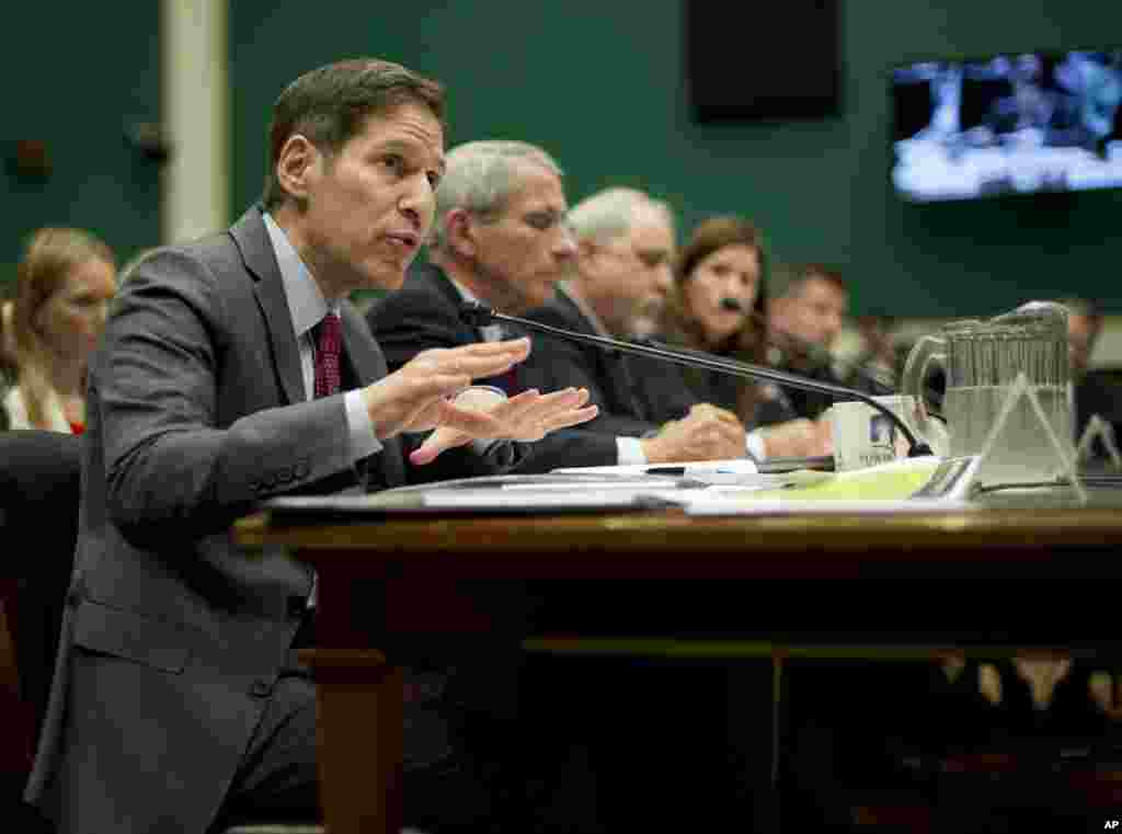 Centers for Disease Control and Prevention (CDC), Director Dr. Tom Frieden (far left) testifies as he sits on a panel with from second from left, Dr. Anthony Fauci, director of The National Institute of Allergy and Infectious Diseases, Dr. Robin Robinson and several others to testify on Capitol Hill, Washington, Oct. 16, 2014.