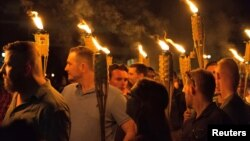 "White supremacists carry torches on the grounds of the University of Virginia, on the eve of a planned ""Unite the Right"" rally in Charlottesville, Virginia, Aug. 11, 2017. (Alejandro Alvarez/News2Share via REUTERS)"