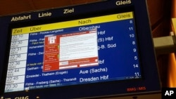 A display panel with an error can be seen at the main railway station in Chemnitz, Germany, May 12, 2017. Deutsche Bahn said early Saturday that departure and arrival display screens at its stations were hit Friday night by the attack.