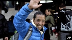Nepalese veteran mountaineer Apa, also known as Apa Sherpa, who has climbed Everest a record 20 times, waves to supporters at the airport before leaving for Mount Everest on an expedition to clear away tons of trash left on the world's highest peak, in Ka