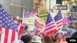 Demonstrasi menentang undang-undang imigrasi di Arizona dilakukan di berbagai kota di Amerika.