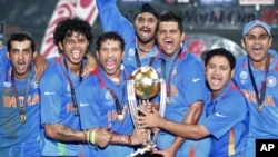 India's players hold the winning trophy as they celebrate their victory over Sri Lanka at ICC Cricket World Cup final match in Mumbai, April 2, 2011.