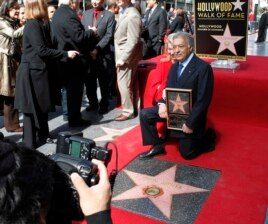 International orchestral and operatic conductor Zubin Mehta and his wife Nancy pose during ceremonies honoring Mehta with a star on the Hollywood Walk of Fame in Hollywood, California, March 1, 2011.
