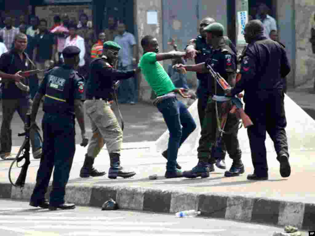 Nigerian police surround a protester during a Lagos demonstration against ending a fuel subsidy. (Reuters)