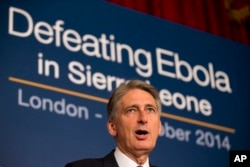 British Foreign Secretary Philip Hammond speaks as he holds a press conference with British International Development Secretary Justine Greening at an Ebola conference at Lancaster House in London, Oct. 2, 2014.