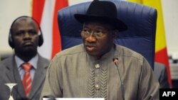 Nigerian President Goodluck Jonathan reads his opening address during an ECOWAS Summit gathering west African leaders to plot a military strategy to wrest control of northern Mali from Islamist groups as fears grow over the risks they pose to the region a