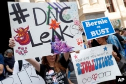 FILE - Demonstrators make their way around downtown, Monday, July 25, 2016, in Philadelphia, during the first day of the Democratic National Convention after some of the 19,000 emails, presumably stolen from the DNC by hackers, were posted to the website WikiLeaks.