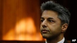 British businessman Shrien Dewani, accused of orchestrating the killing of his wife, Anni Dewani, appears in the high court in Cape Town, South Africa, Oct. 6, 2014.