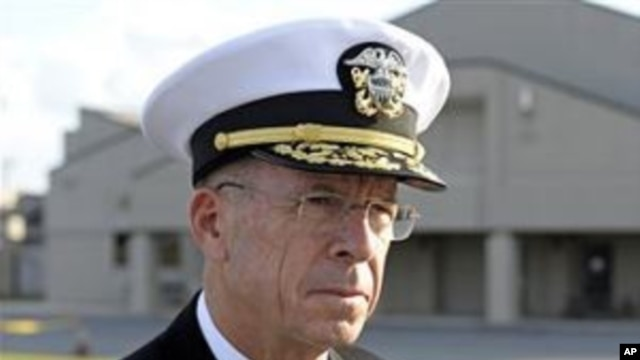 Adm. Michael Mullen, Chairman of the Joint Chiefs of Staff at Dover Air Force Base, Del., 15 Oct 2010