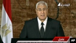 This image pulled from video broadcast on Egyptian state TV shows interim President Adly Mansour making his first address to the nation since assuming his post after the ouster of Islamist President Mohamed Morsi, in Cairo, July 18, 2013.