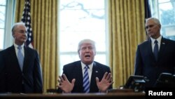 FILE - President Trump reacts to the AHCA health care bill being pulled by Congressional Republicans before a vote as he appears with Secretary of Health and Human Services Tom Price (L) and Vice President Mike Pence (R) in the Oval Office of the White House in Washington, March 24, 2017.