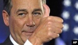 Le député républicain John Boehner de l'Ohio, alors chef de file de la minorité républicaine à la Chambre, célébrant, le 3 novembre, la victoire électorale qui allait remettre les républicains en selle