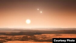 The view from one of the newly identified planets would be spectacular. They orbit the fainter of the three stars in the system, and the other two stars would be visible in the daytime. (Credit: ESO)