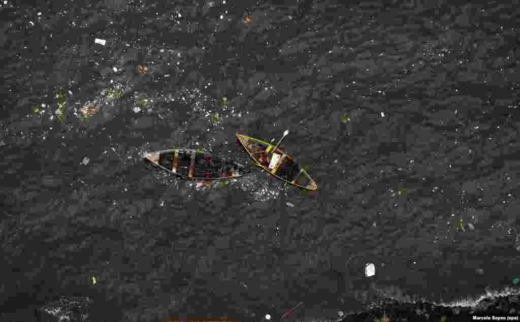 Fishermen are seen in polluted Guanabara Bay, where the Sailing competitions at the 2016 Rio Olympic Games will be held, in Rio de Janeiro, Brazil.