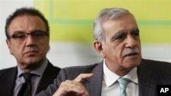 Pro-Kurdish Peace and Democracy Party lawmakers Ahmet Turk, right, and Sirri Sakik at news conference, Ankara, Turkey, Jan. 13, 2012.