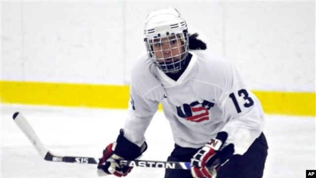 FILE - Julie Chu scrimmages with the U.S. Women's National Hockey team, National Sports Center, Blaine, Minnesota, Aug. 20, 2009.