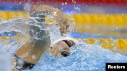 China's Ye Shiwen swims to win the women's 200m individual medley final during the London 2012 Olympic Games at the Aquatics Centre July 31, 2012.