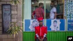 A security guard sits near a gate in Addis Ababa, Ethiopia, Oct. 10, 2016.