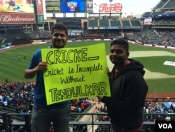Cricket icon Sachin Tendulkar's fans hold a sign at Citi Field in New York before the start of an all-star contest featuring retired stars, Nov. 7, 2015.