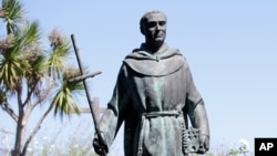 FILE - A statue of Junipero Serra at the Carmel Mission, Sept. 23, 2015, in Carmel-By-The-Sea, California.