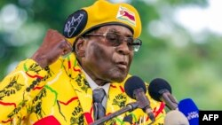 (FILES) This file photo taken on November 08, 2017 shows Zimbabwe's President Robert Mugabe addressing party members and supporters gathered at his party headquarters to show support to Grace Mugabe becoming the party's next Vice President after the dismi