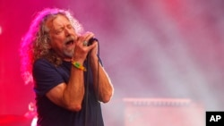 FILE - Robert Plant and The Sensational Space Shifters perform at the Bonnaroo Music and Arts Festival in Manchester, Tenn. Plant is going on tour in North America next year to support his upcoming album, 'Carry Fire.'